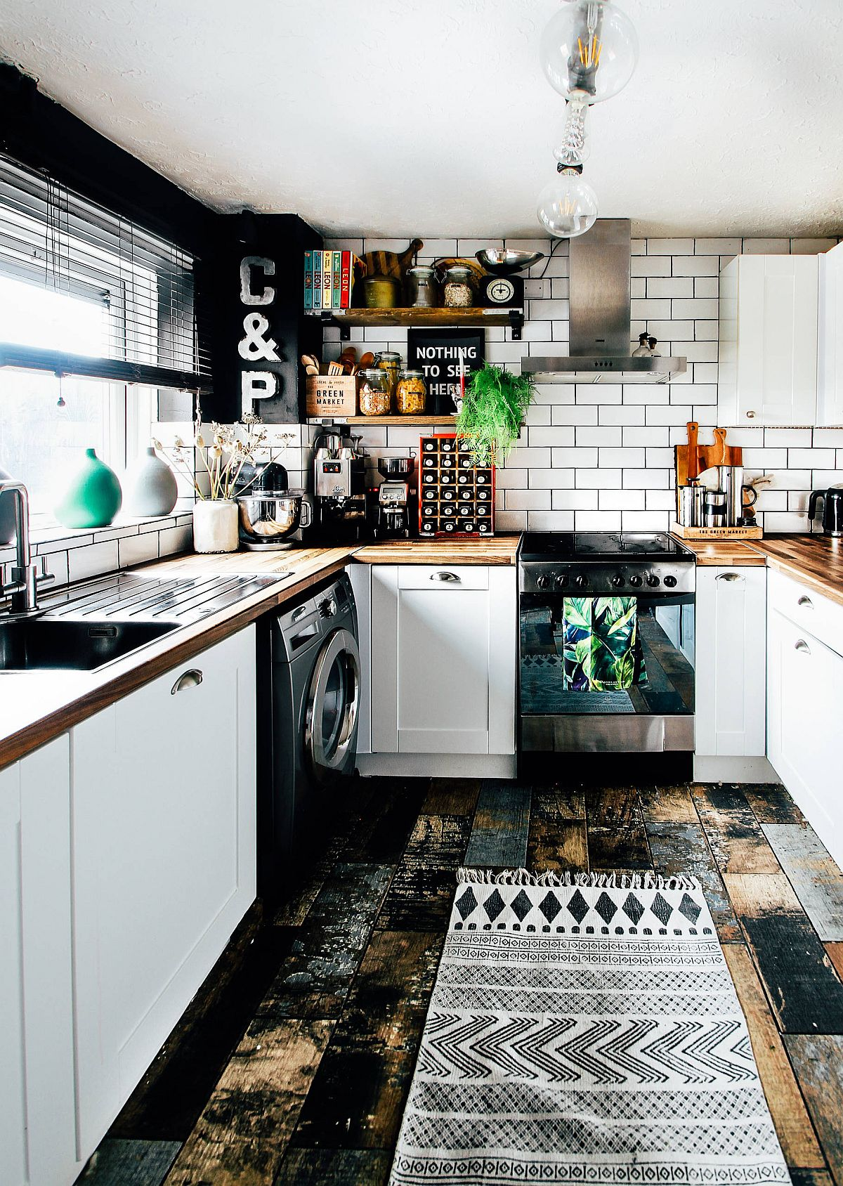 Reclaimed-wood-floor-and-white-cabinets-combined-elegnatly-in-this-small-eclectic-kitchen-37269