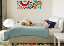 Rug-wall-art-piece-and-cushions-bring-bright-floral-pattern-to-this-kids-room-21388-217x155