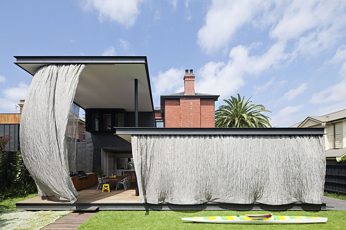 Series of canopies at different heights cover the extreior area of the house