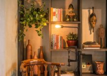 Shelf-with-modern-industrial-design-and-a-series-of-books-and-decorative-pieces-on-it-99067-217x155