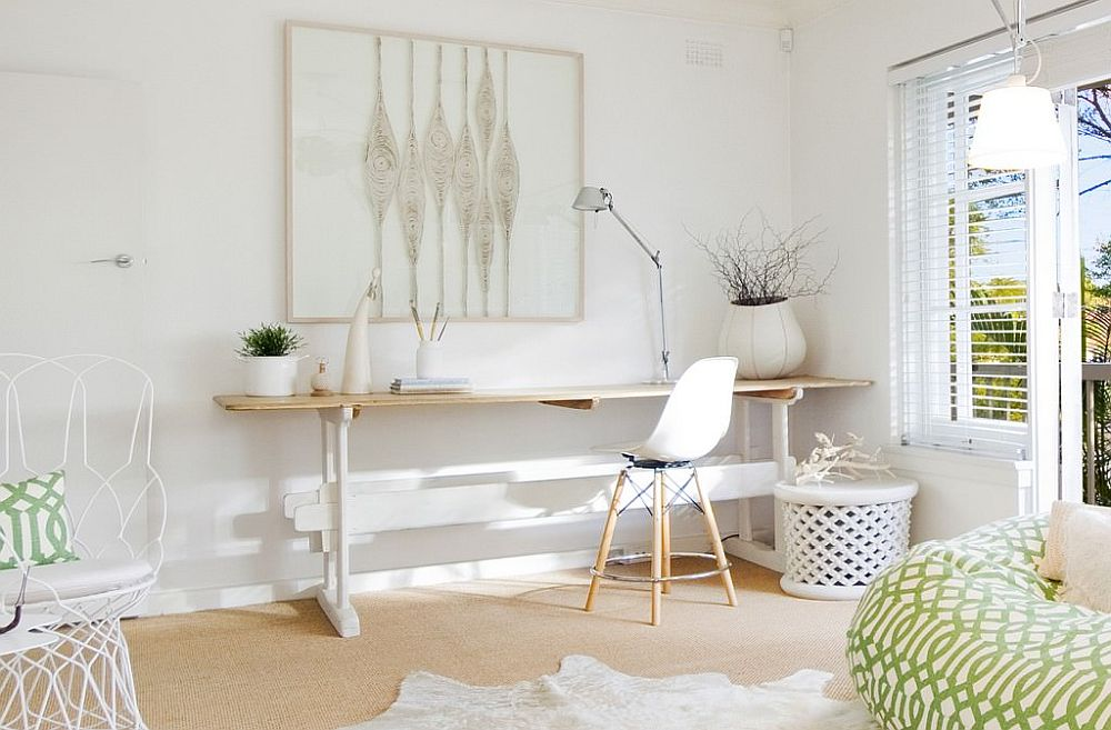 Simple and sleek desk coupled with a comfortable chair in white for a stylish home workspace