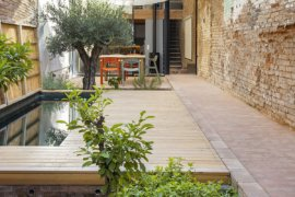World of Textural Charm: Aging Single-Family Home Extension in Spain