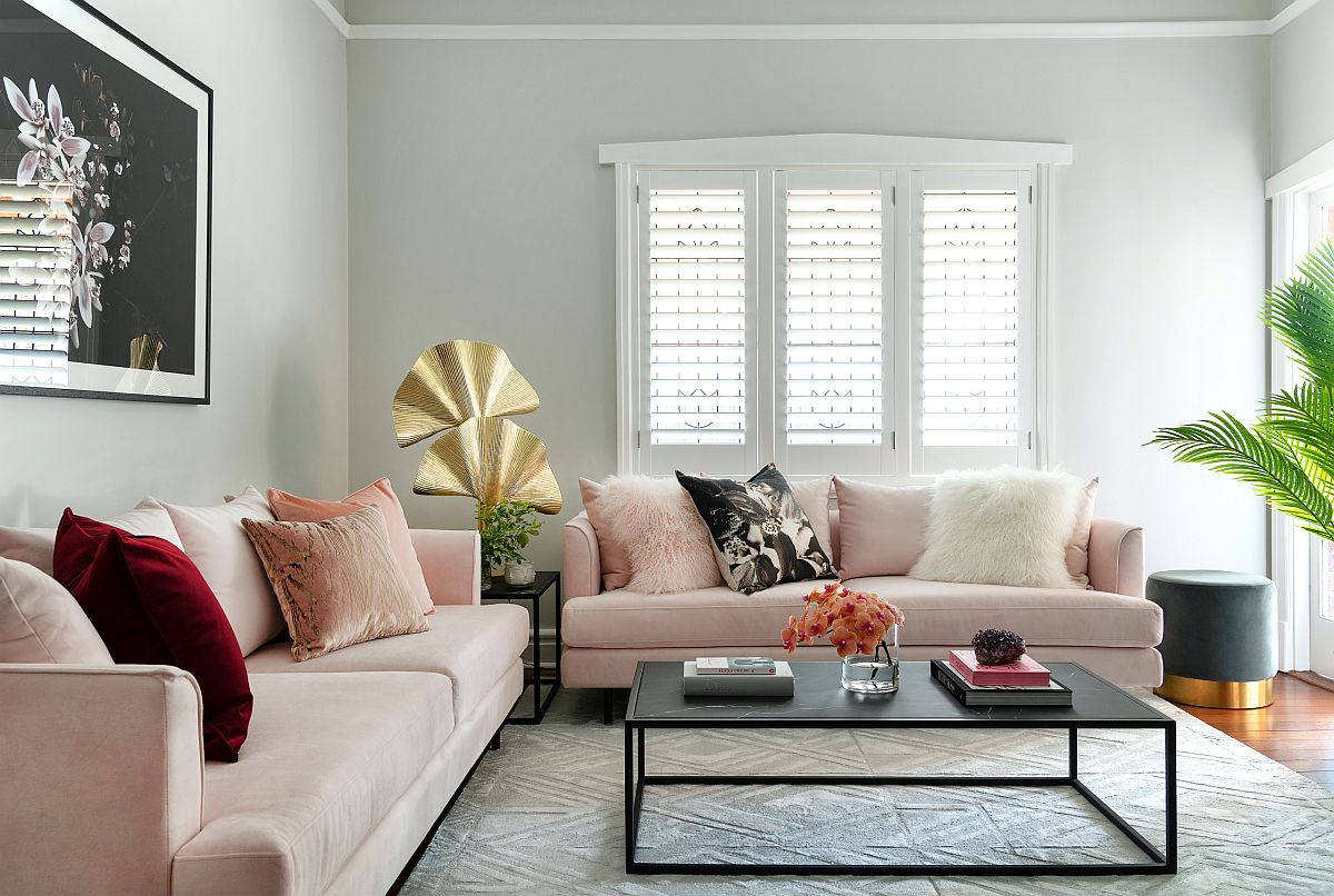 Single accent pillow in scarlet brings colorful charm to this lovely living room
