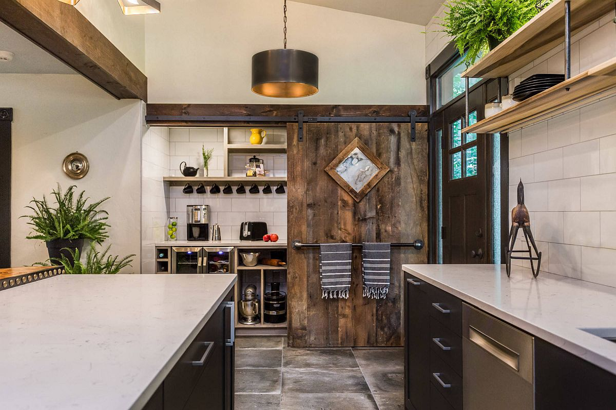 Sliding barn style door for the small industrial pantry in the spacious modern kitchen