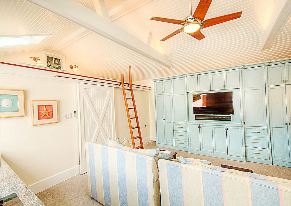 Small beach style home theater with wall-mounted TV and comfortable striped chairs in white and blue