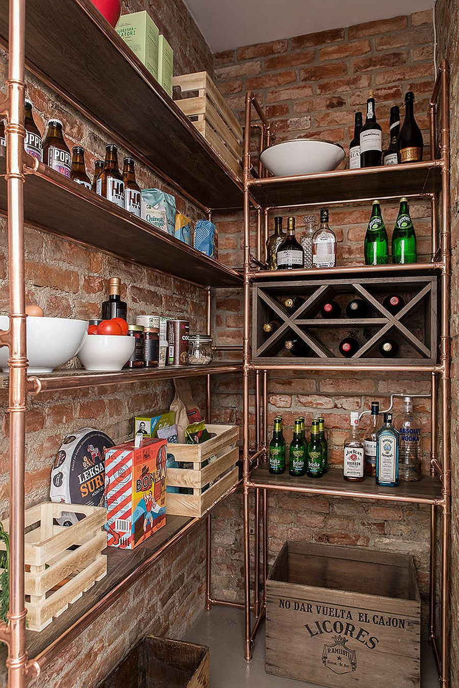 Small industrial style pantry with brick walls and simple metallic shelves