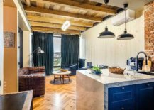 Small-modern-industrial-living-room-with-plush-leather-sofa-brick-walls-and-wooden-ceiling-53137-217x155