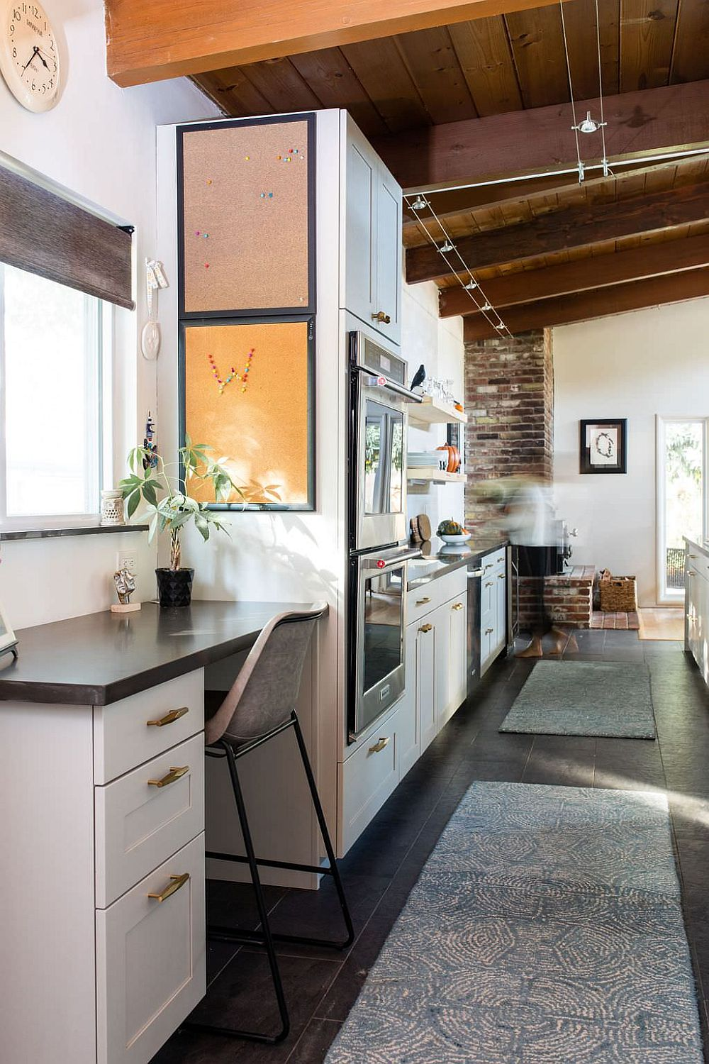 Small niche next to the kitchen transformed into a midcentury modern home workspace
