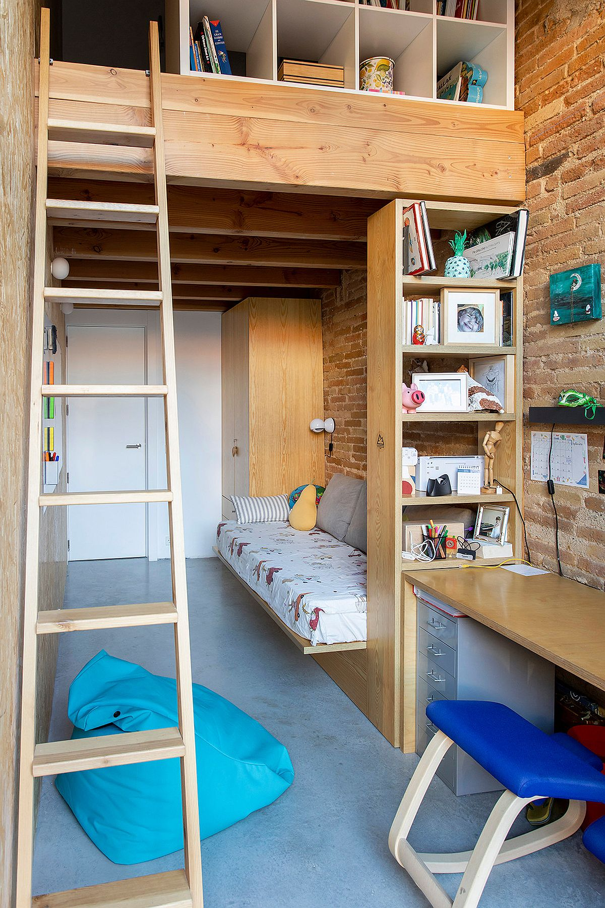 Space-savvy-industrial-style-bedroom-with-brick-walls-concrete-floor-and-a-loft-level-94412