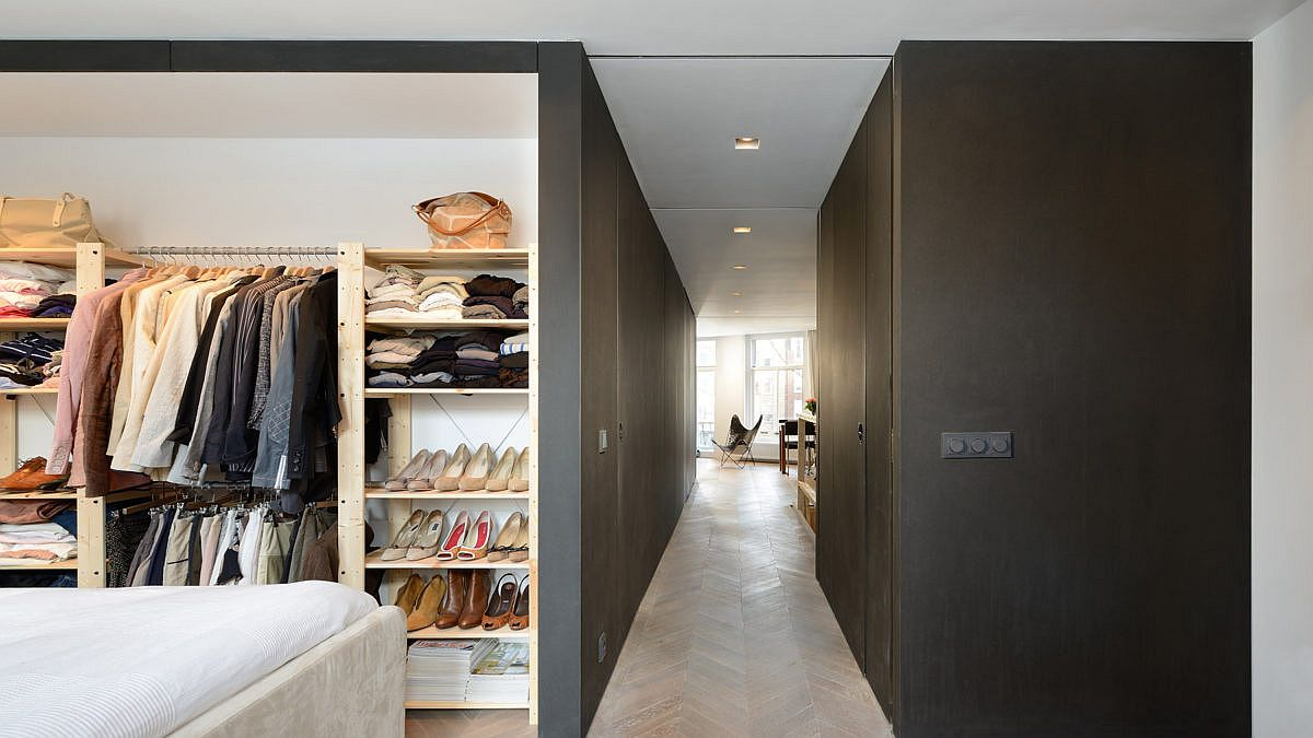 Spacious closet inside the modern minimal master bedroom