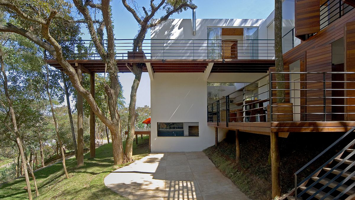 Spacious modern forest house with a series of walkways around it