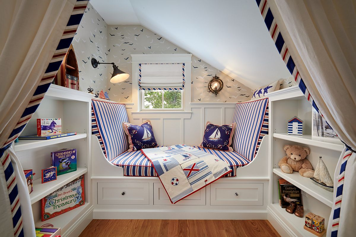 Spacious nook in the hallway turned into a cozy play area with custom seat, shelves and drapes