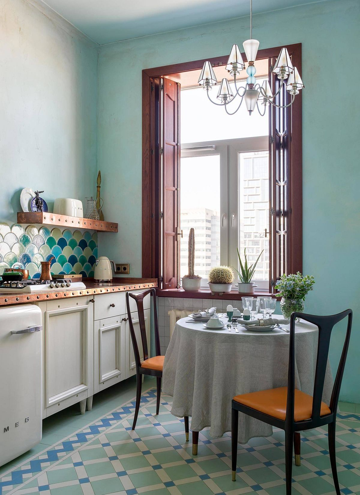 Stylish-eat-in-kitchen-in-blue-with-multi-colored-tiles-and-plenty-of-blue-30816