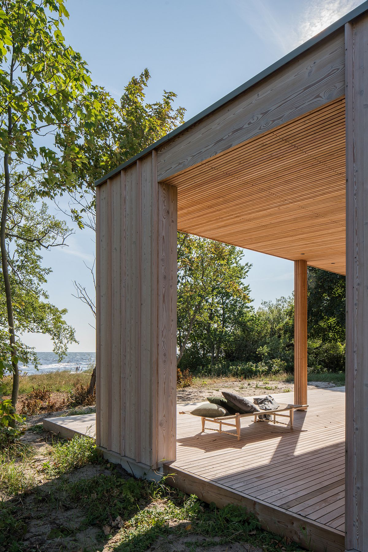 Sun-soaked deck of the house allows the homeowners to enjoy the many sights and sounds next to the baltic sea