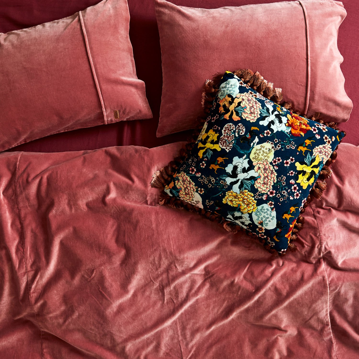 Tasseled floral pillow from Kip & Co.