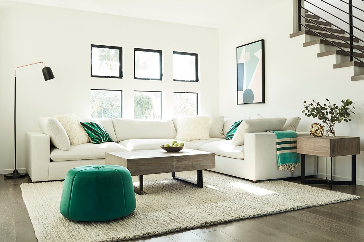 Teal ottoman and accents