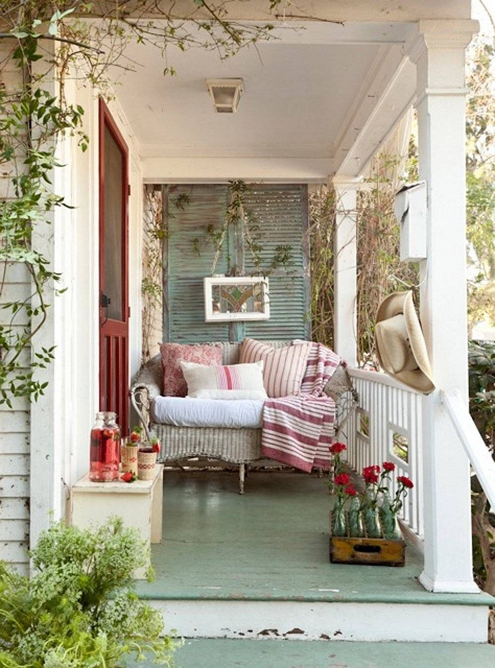 Timeless vintage charm is captured in a picture-perfect manner by this small porch