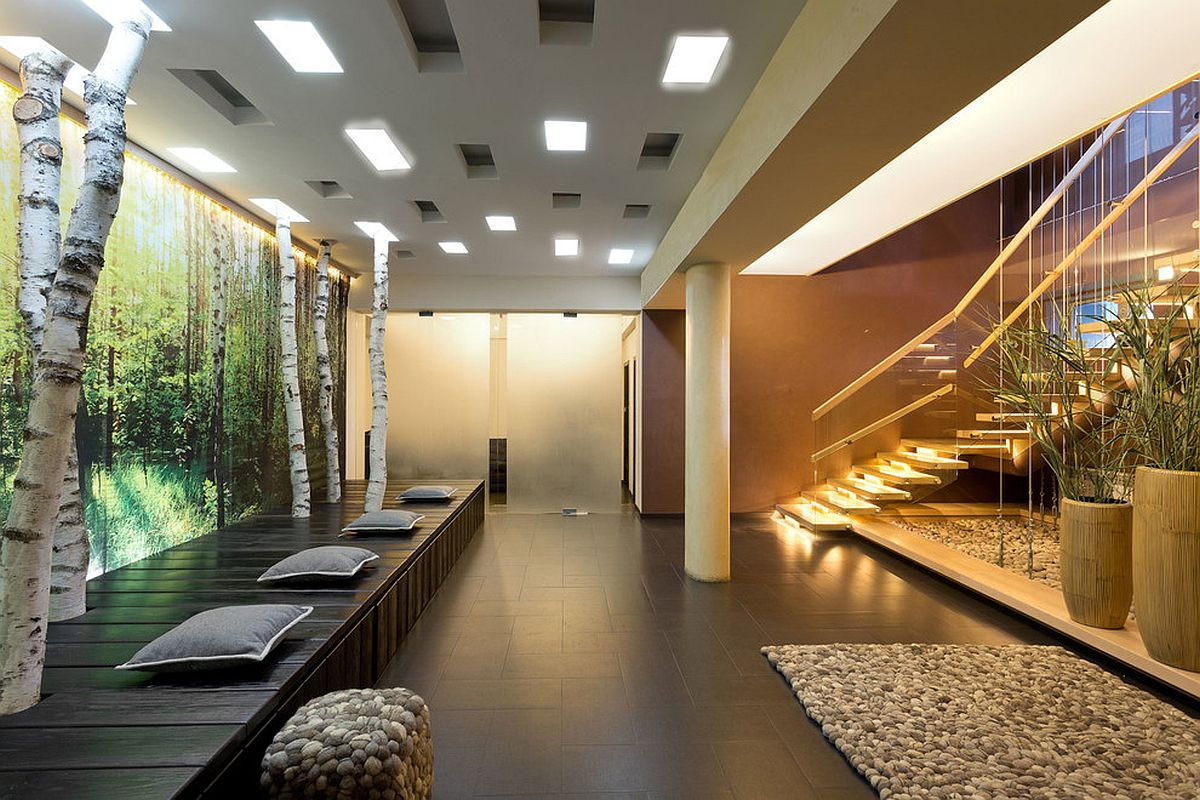 Turning the entry into a stunning hangout with custom features and lighting that sets the mood