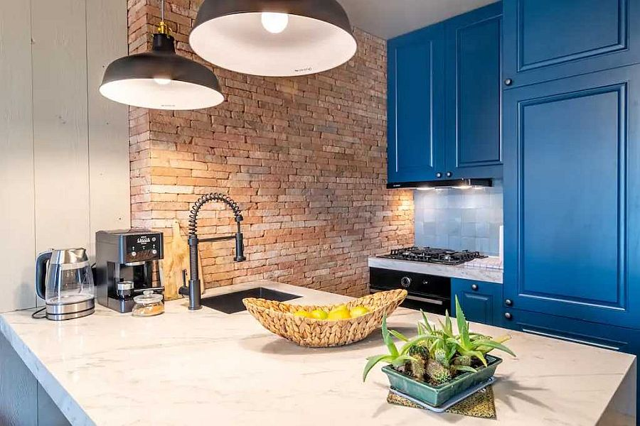 Two-large-pendant-lights-illuminate-the-small-and-functional-kitchen-counter-77498