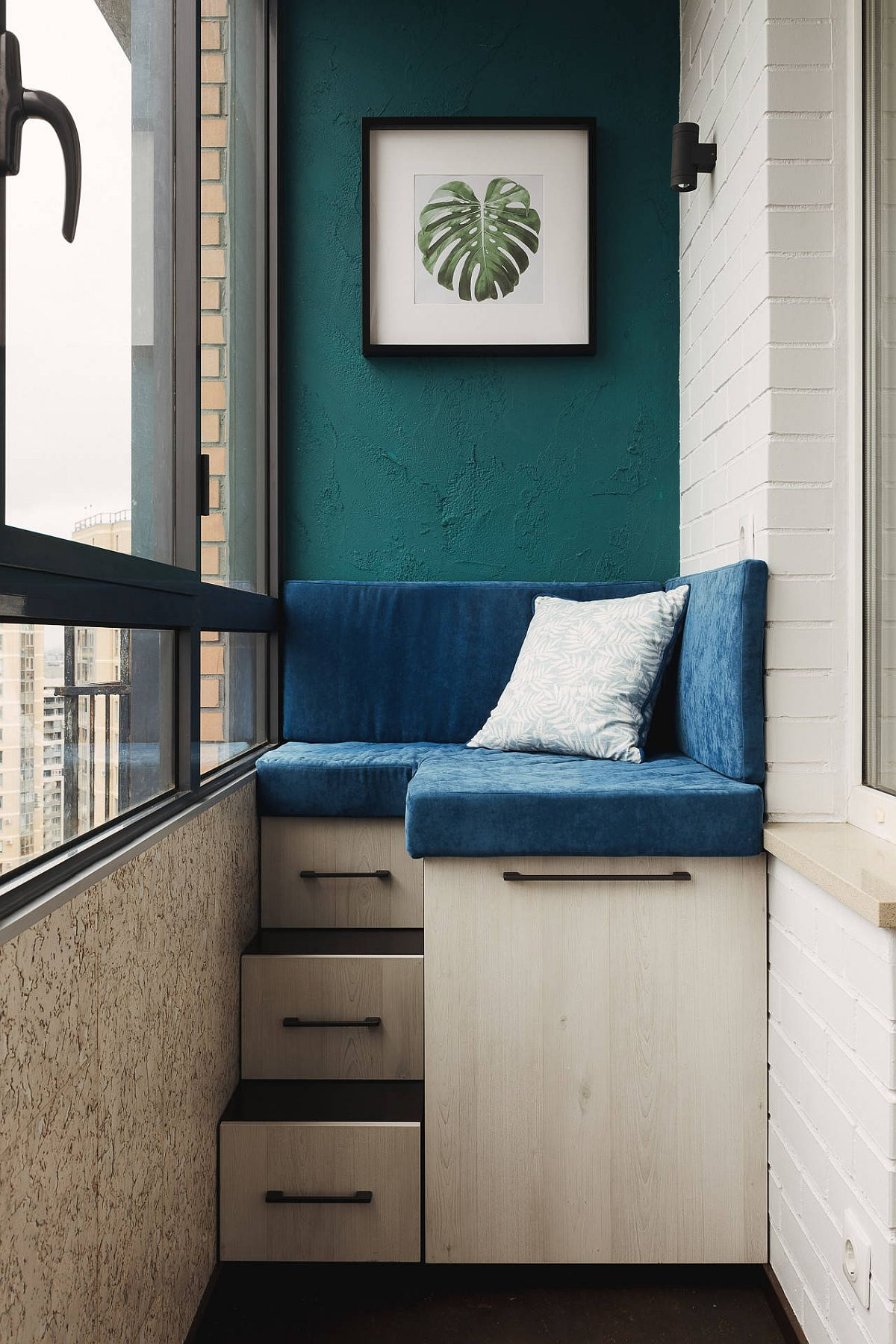 Ultra-small modern balcony with a corner custom bench that offers plenty of storage space