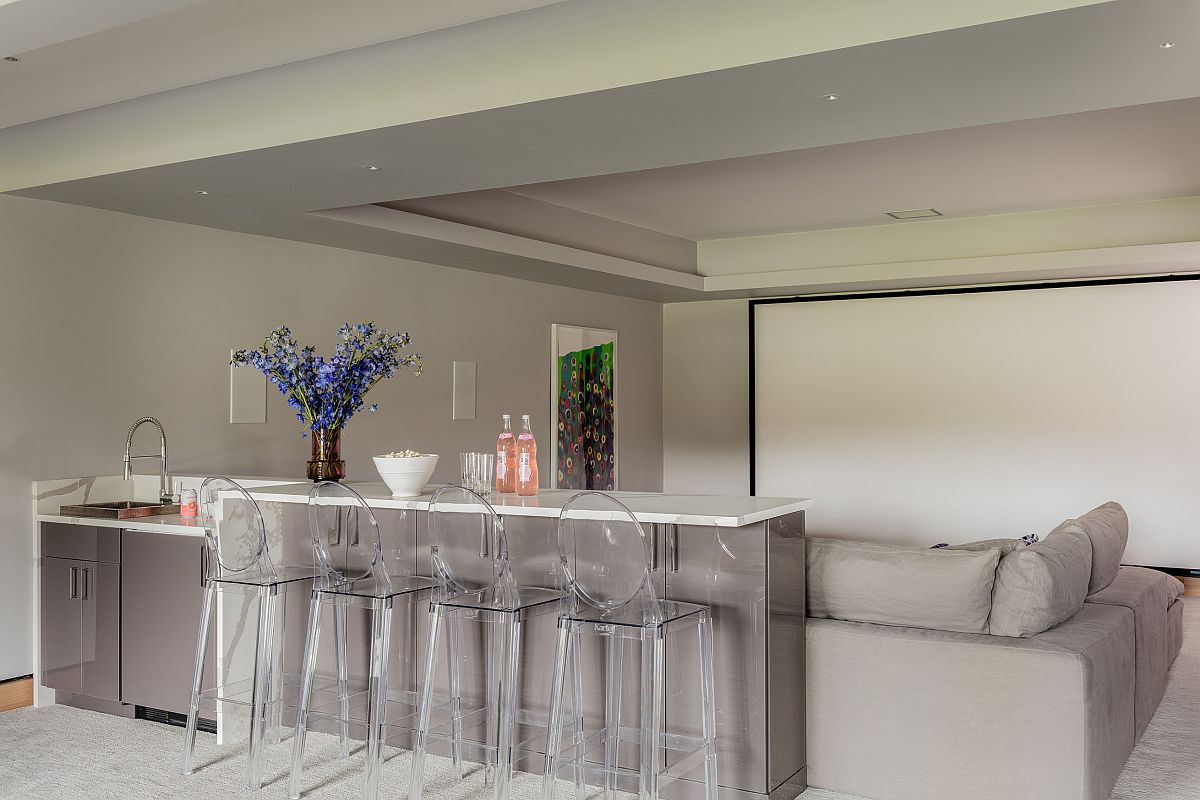 Use a screen to turn the breakfast bar and space next to it into a home theater