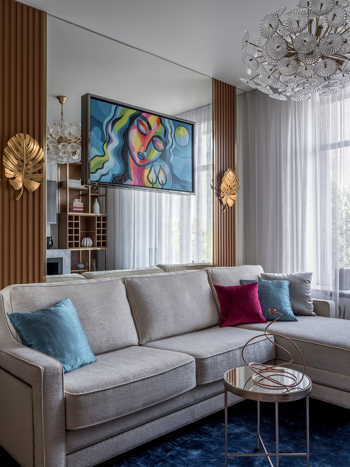 Using accent pillows in multple hues in the modern living room gives it a brighter vibe