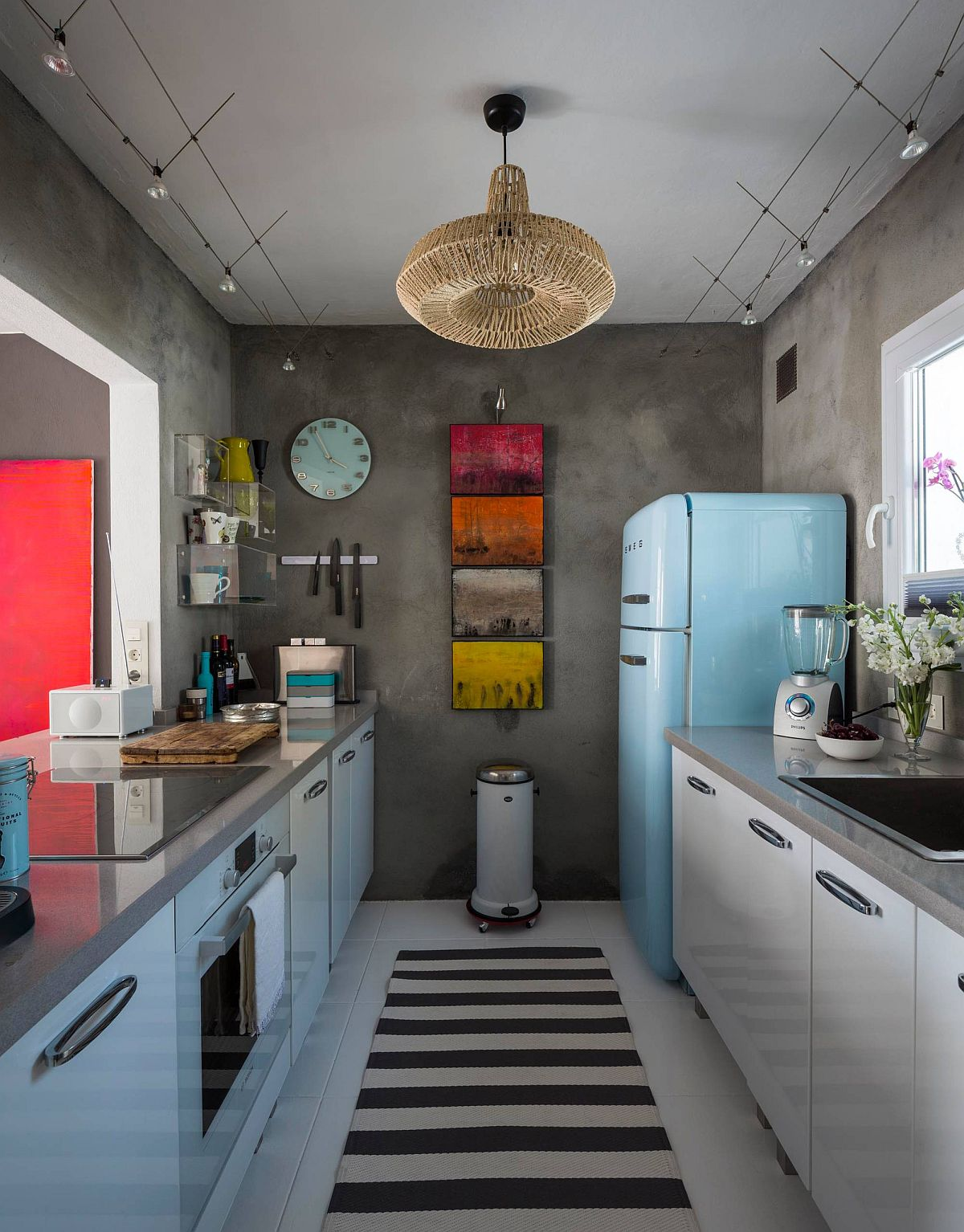 Using-vintage-fridge-to-add-color-to-the-small-eclectic-kitchen-with-concrete-walls-42790