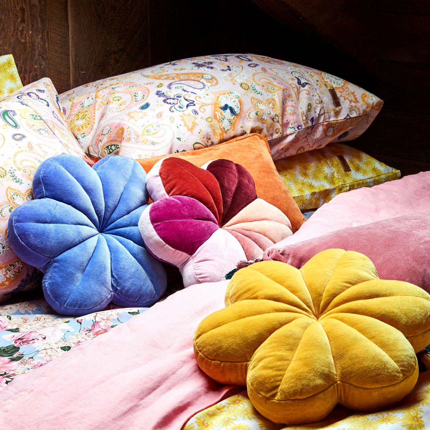 Velvet floral pillows in bright colors
