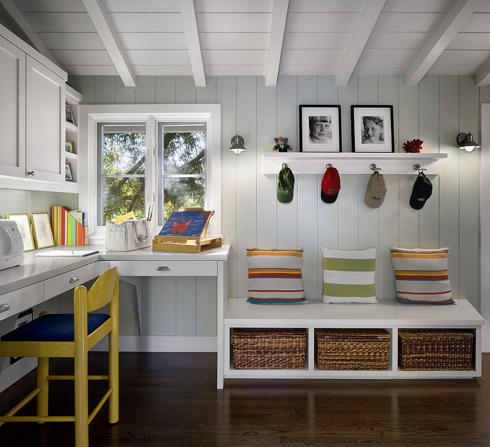 White and gray have been combined with beuatiful pops of color in this mudroom that doubles as home workspace
