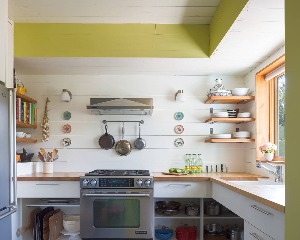 White and wood small eclectic kitchen with a healthy dose of yellow thrown into the mix