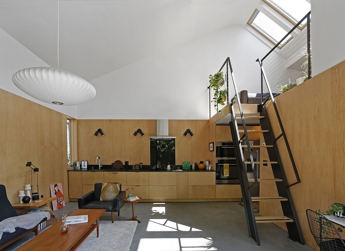 Wood and white along with heated concrete floors shape the interior of the house
