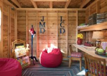 Wooden-walls-and-shelves-give-the-playroom-a-summer-cabin-inspired-look-32428-217x155