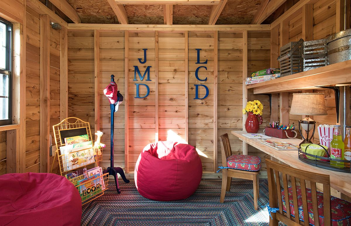 Wooden-walls-and-shelves-give-the-playroom-a-summer-cabin-inspired-look-32428
