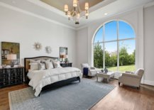 Arched-window-brings-Mediterranean-charm-to-the-moderh-bedroom-in-white-73954-217x155