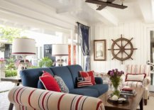 Beautiful-beach-style-porch-of-San-Deigo-home-with-bright-blue-couch-and-striped-chairs-in-cream-blue-and-red-31419-217x155