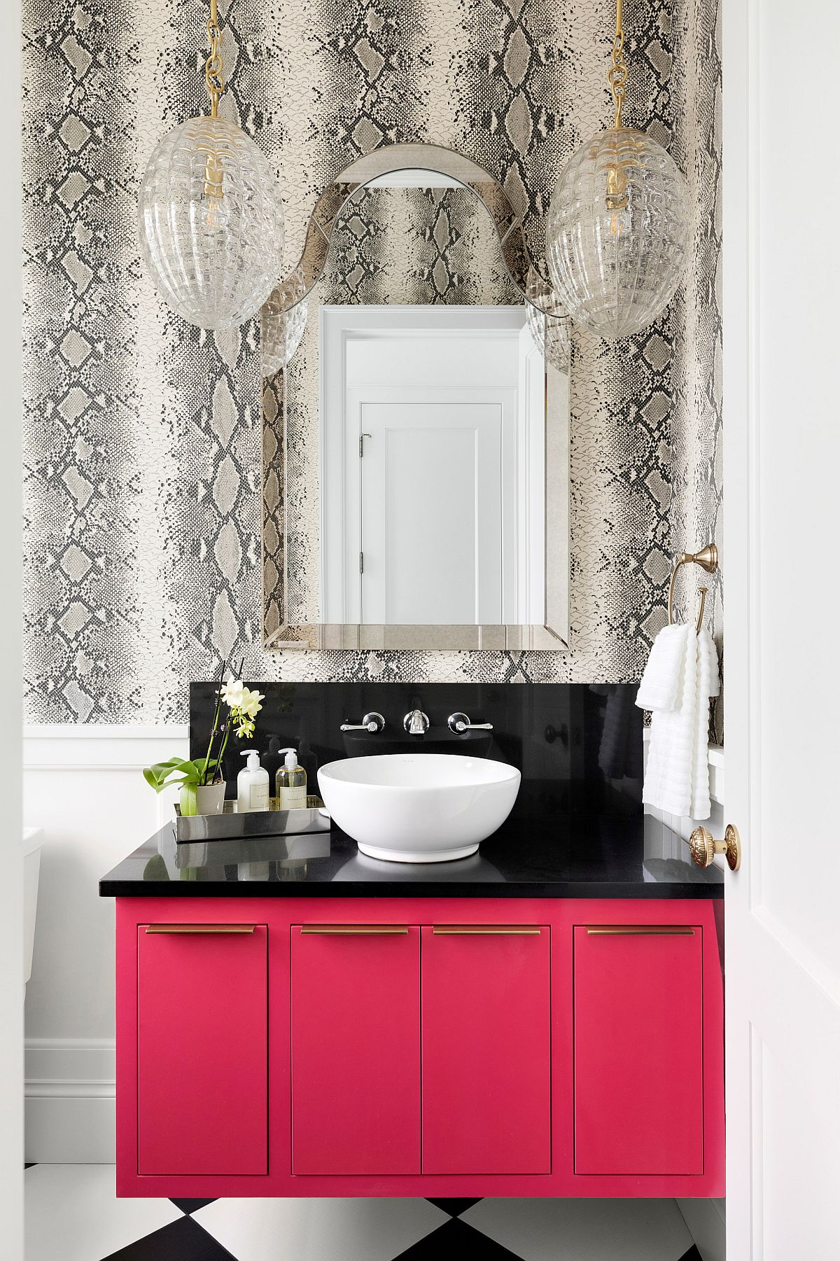 Black and pink vanity steals the show in this bathroom
