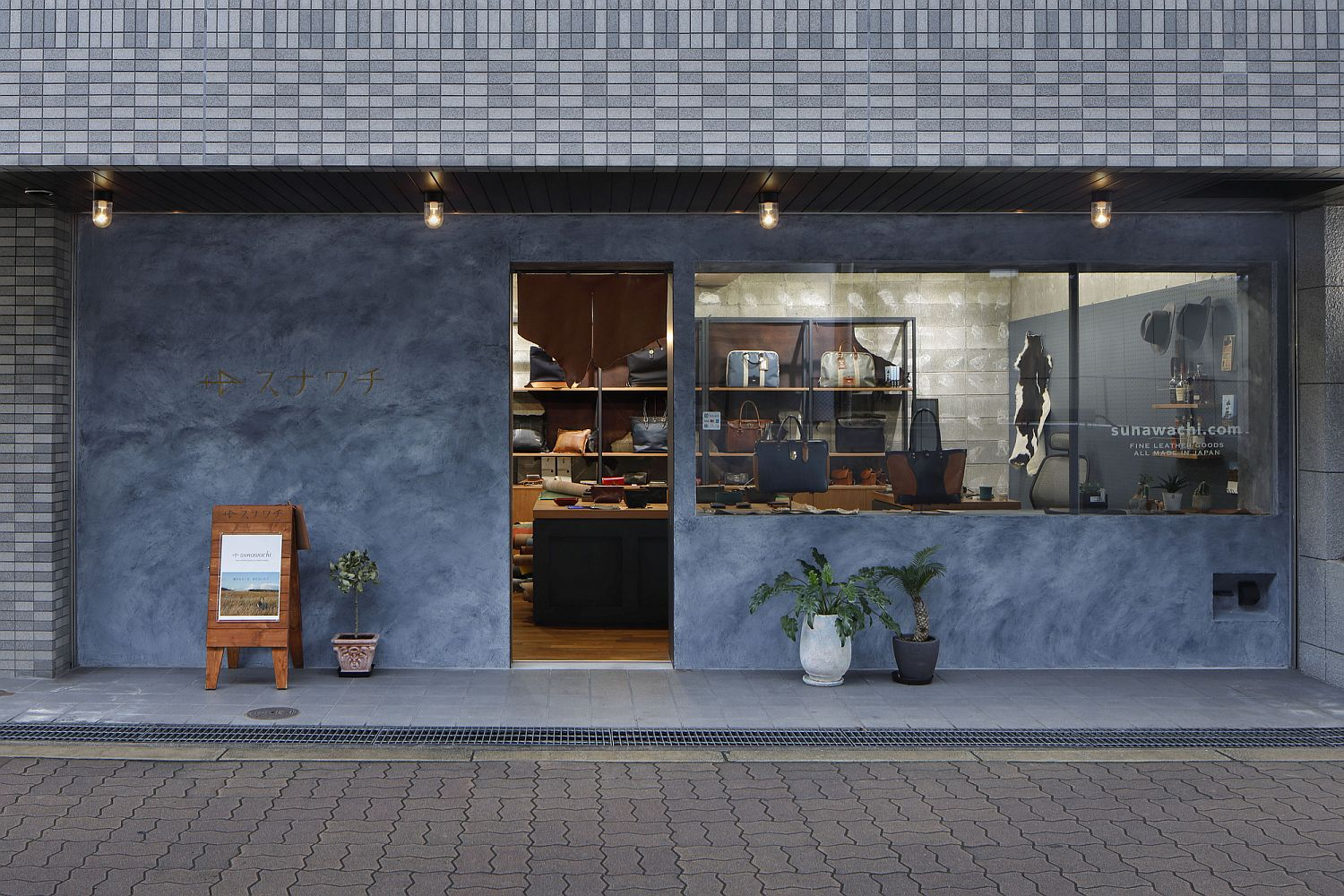Blue exterior and street facade of leather shop in Osaka, Japan