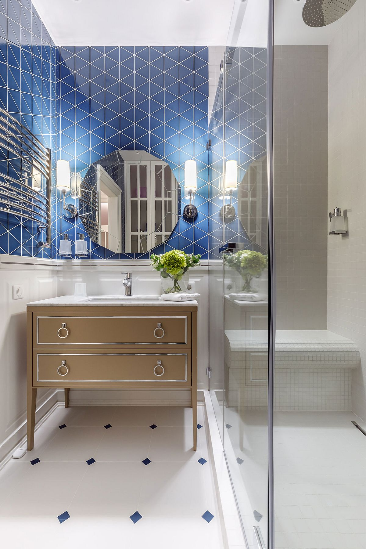 Blue tiles in the backdrop bring both color and pattern to this small white bathroom
