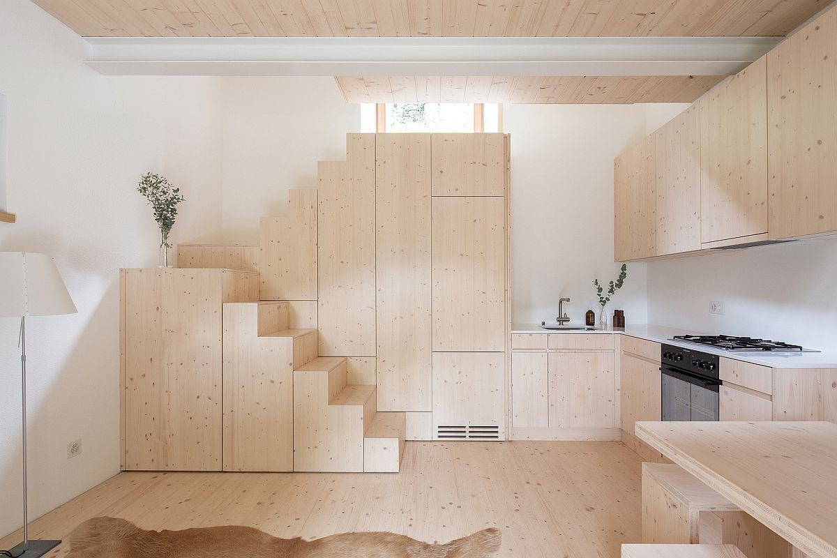 Box-styled-steps-and-series-of-wooden-cabinets-maximize-space-inside-the-small-holiday-home-in-Siwtzerland-73336