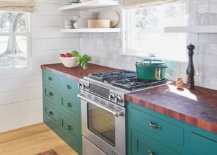 Butcher-block-kitchen-coutertops-combined-with-teal-cabinets-and-white-tiled-backsplash-24345-217x155