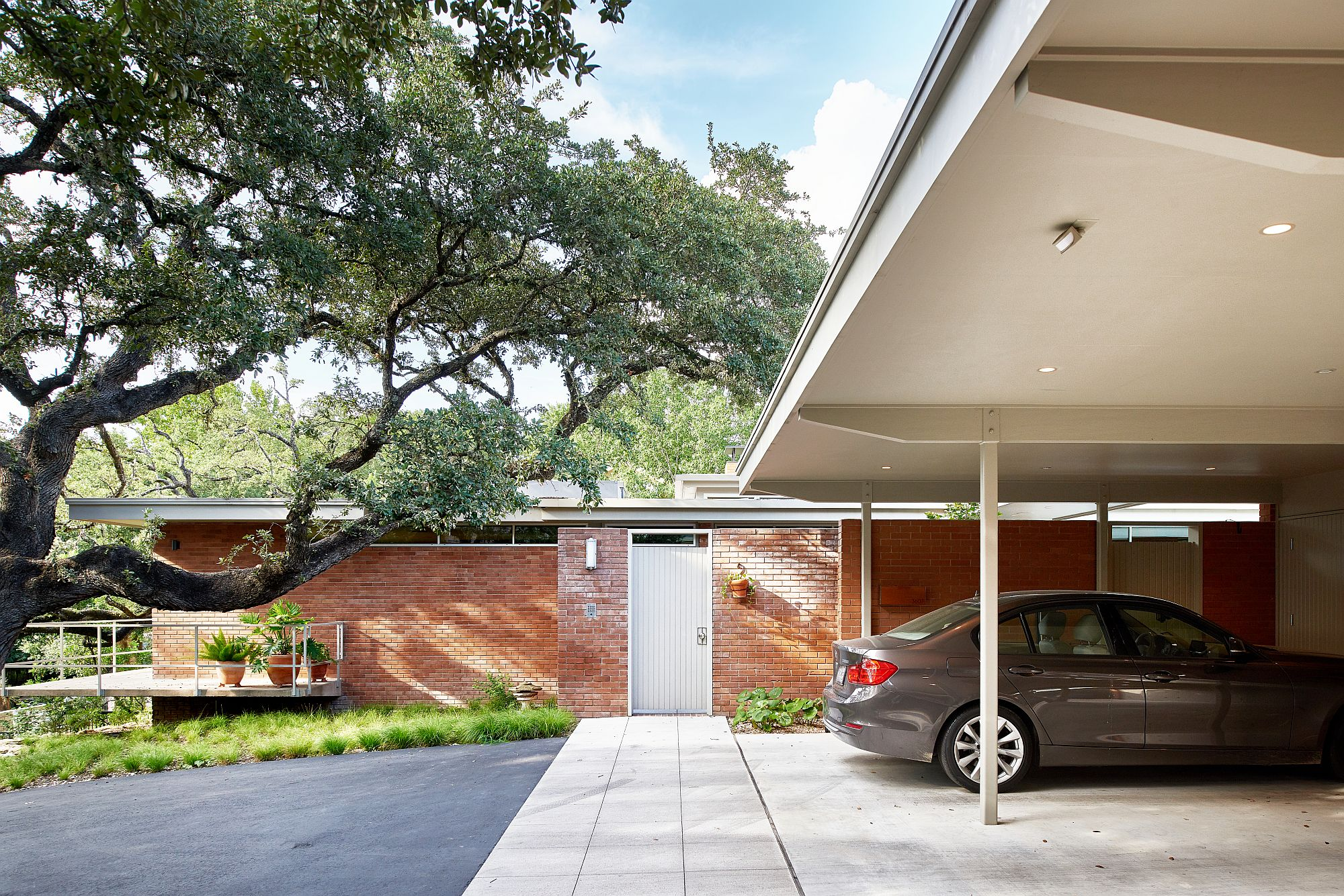 Carport and entry at the Balcones Residence