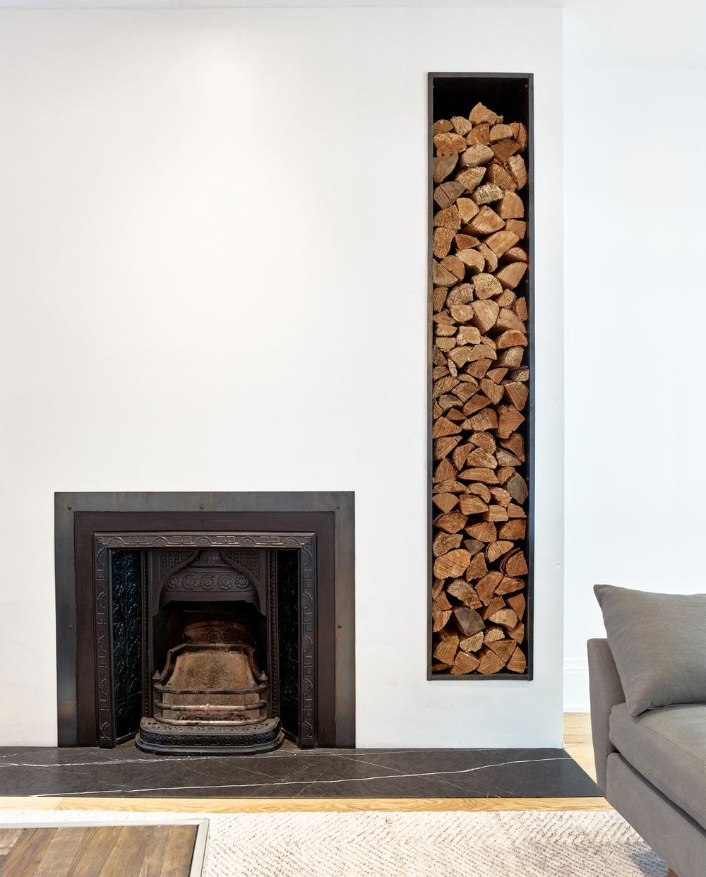 Classic fireplace of the house was kept intact while revamping the space around it