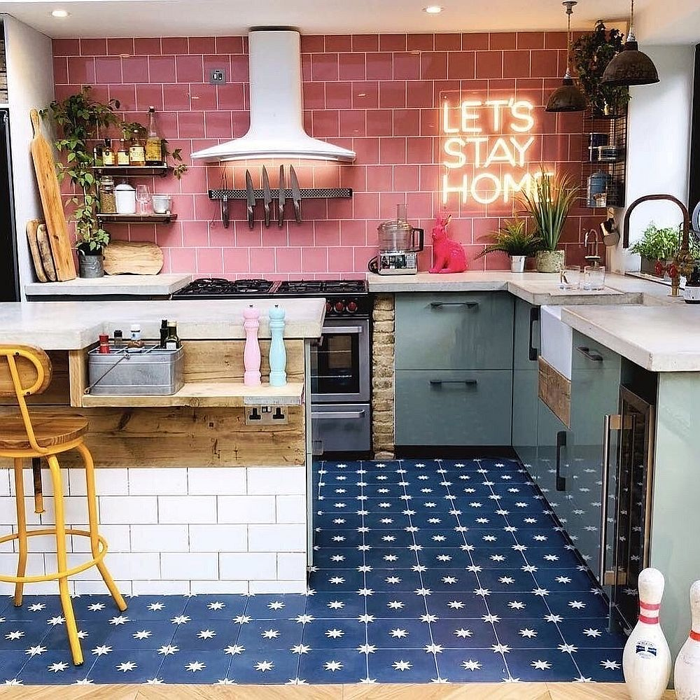 Color-filled kitchen in blue and pink with dashing neon sign