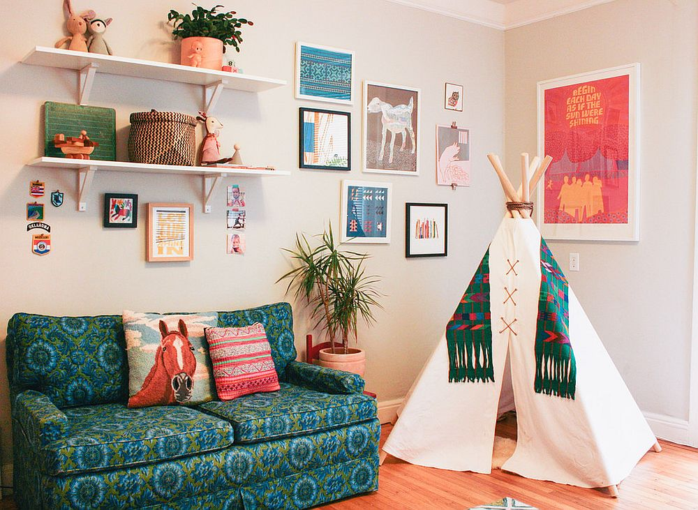 Comfy sofa and teepee in the corner bring added charm to the small nursery