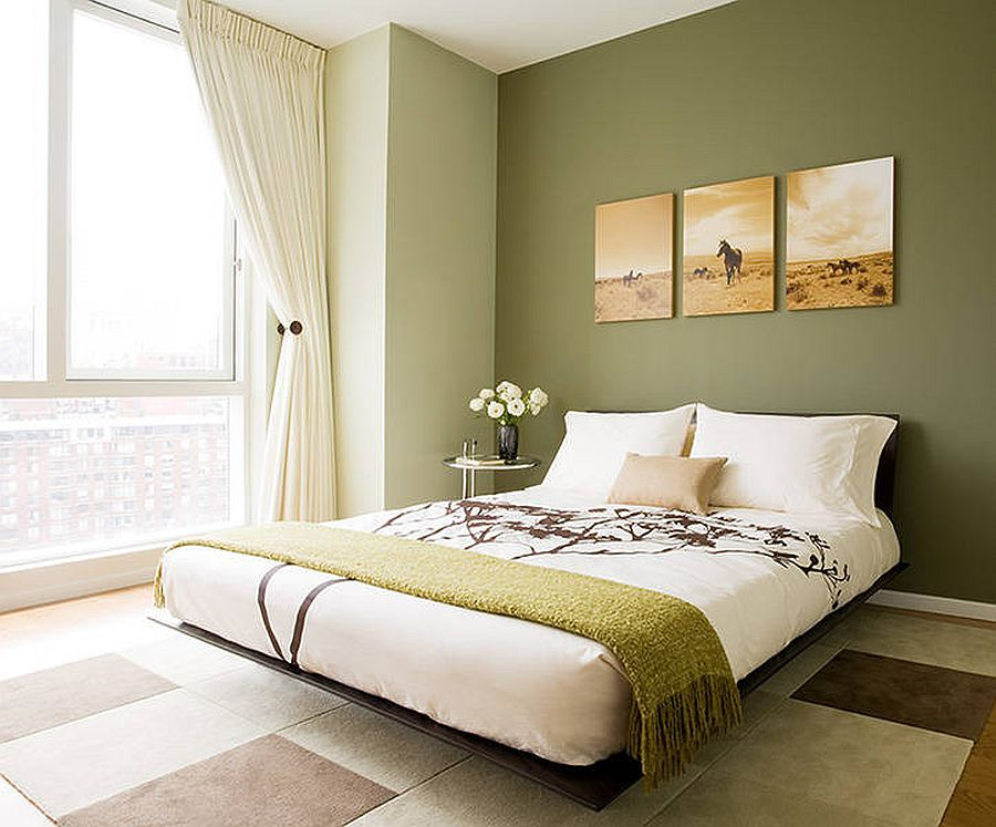 bedroom with olive green walls and accent green throw