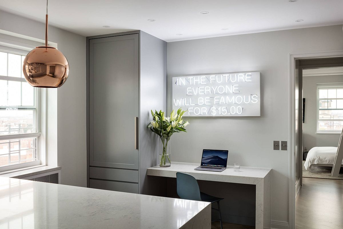 Contemporary industrial kitchen in gray with home workspace and a bright neon sign