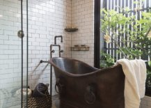 Copper-bathtub-alog-with-glass-walls-and-greenery-adds-uniqueness-to-the-bathroom-80077-217x155