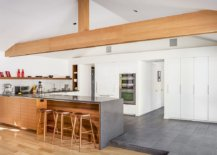 Countertops-and-flooring-brings-gray-to-the-modern-kitchen-in-white-while-wooden-island-and-ceiling-beams-add-warmth-56606-217x155