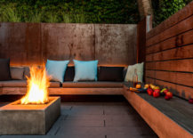 Cozy-conversation-pit-with-fireplace-at-its-heart-and-a-green-wall-all-around-84644-217x155