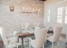 Curated-modern-dining-room-with-white-walls-coupled-with-brick-walls-38341-217x155